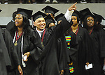 Dustin Dean waves to friends and familiy in the stands at the Texas Southern University commencement Saturday May 16,2009.(Dave Rossman/For the Chronicle)