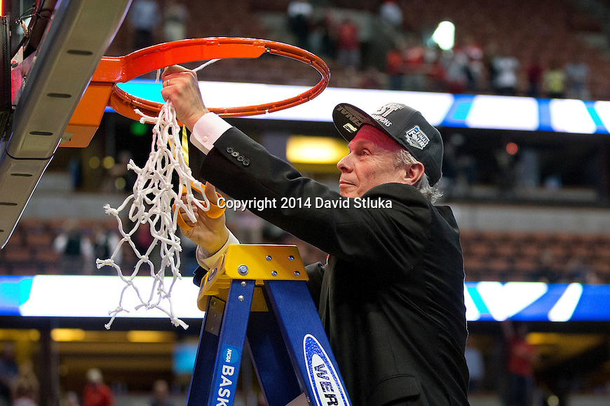 Wisconsin Badgers Head Coach Bo Ryan cuts down a piece of the net after the Western Regional Final NCAA college basketball tournament game against the Arizona Wildcats Saturday, March 29, 2014 in Anaheim, California. The Badgers won 64-63 (OT). (Photo by David Stluka)