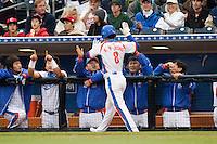 19 March 2009: #8 Keun Woo Jeong of Korea is congratulated by teammates after scoring against Japan during the 2009 World Baseball Classic Pool 1 game 6 at Petco Park in San Diego, California, USA. Japan wins 6-2 over Korea.