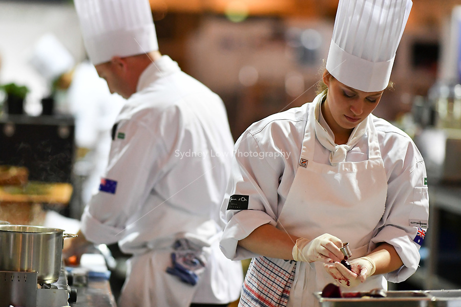 Melbourne, 30 May 2017 - Laura Skvor commis chef assisting Michael Cole of the Georgie Bass CafÈ & Cookery in Flinders prepares a garnish at the Australian selection trials of the Bocuse d'Or culinary competition held during the Food Service Australia show at the Royal Exhibition Building in Melbourne, Australia. Photo Sydney Low
