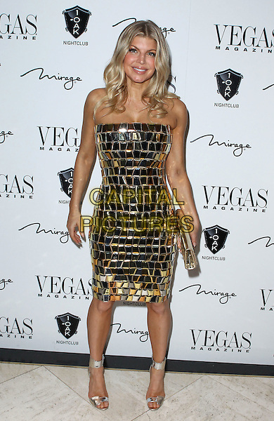 Fergie (Stacy Ferguson) .Fergie hosts New Year's Eve Bash at the Premiere of 1 OAK Las Vegas at the Mirage,  Las Vegas, Nevada, USA, 31st December 2011..full length dress clutch bag  strapless gold mirror tiled  shiny silver strappy open toe ankle strap shoes sandals .CAP/ADM/MJT.© MJT/AdMedia/Capital Pictures.