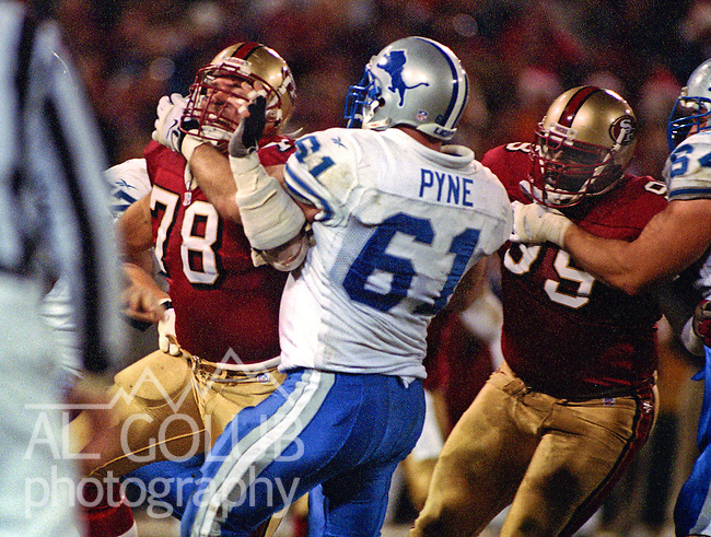 San Francisco 49ers vs. Detroit Lions at Candlestick Park Monday, December 14, 1998.  49ers beat Lions  35-13.  Detroit Lions center Jim Pyne (61) holds San Francisco 49ers defensive tackle Shane Bonham (78).