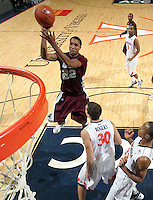 CHARLOTTESVILLE, VA- December 27: Ron Spencer #22 of the Maryland-Eastern Shore Hawks shoots over Thomas Rogers #30 of the Virginia Cavaliers during the game on December 27, 2011 at the John Paul Jones Arena in Charlottesville, Va. Virginia defeated Maryland Eastern Shore 69-42.  (Photo by Andrew Shurtleff/Getty Images) *** Local Caption *** Thomas Rogers;Ron Spencer