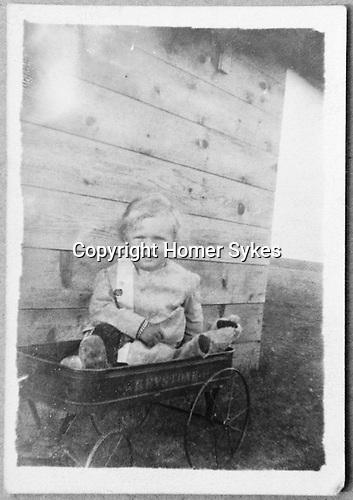 Homer Warwick Sykes ( born 1909 ) Luseland  Canada outside timber cabin. 1911?