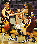 SIOUX FALLS, SD - JANUARY 30:  Taylor Varsho #3 from the University of Sioux Falls passes the ball between Jessica Newman #20 and Taylor Meyer #42 from Minnesota Duluth Friday night at the Stewart Center. (Photo by Dave Eggen/Inertia)