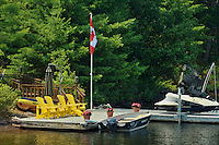 Muskoka chairds on dock<br /> Muskoka Country<br /> Ontario<br /> Canada