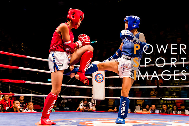 Au Yin Yin Winnie (Red)  of Hong Kong fights against Molomjamts Erdenetuya (Blue) of Mongolia in the female muay 51KG division weight bout during the East Asian Muaythai Championships 2017 at the Queen Elizabeth Stadium on 11 August 2017, in Hong Kong, China. Photo by Yu Chun Christopher Wong / Power Sport Images