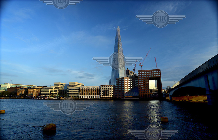 A view from the north side of the River Thames, south to London Bridge (illuminated in Red), and the Shard rising 310 metres in the centre.