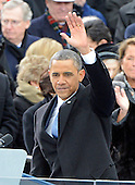 United States President Barack Obama waves to the crowd after delivering his Inaugural Address after taking the oath of office during the public swearing-in ceremony at the U.S. Capitol in Washington, D.C. on Monday, January 21, 2013..Credit: Ron Sachs / CNP.(RESTRICTION: NO New York or New Jersey Newspapers or newspapers within a 75 mile radius of New York City)