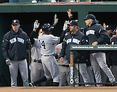 New York Yankees centerfielder Curtis Granderson (14) is congratulated by his teammates after connecting for a 2 run home run in the first inning against the Baltimore Orioles at Oriole Park at Camden Yards in Baltimore, MD on Thursday, April 11, 2012.  .Credit: Ron Sachs / CNP.(RESTRICTION: NO New York or New Jersey Newspapers or newspapers within a 75 mile radius of New York City)