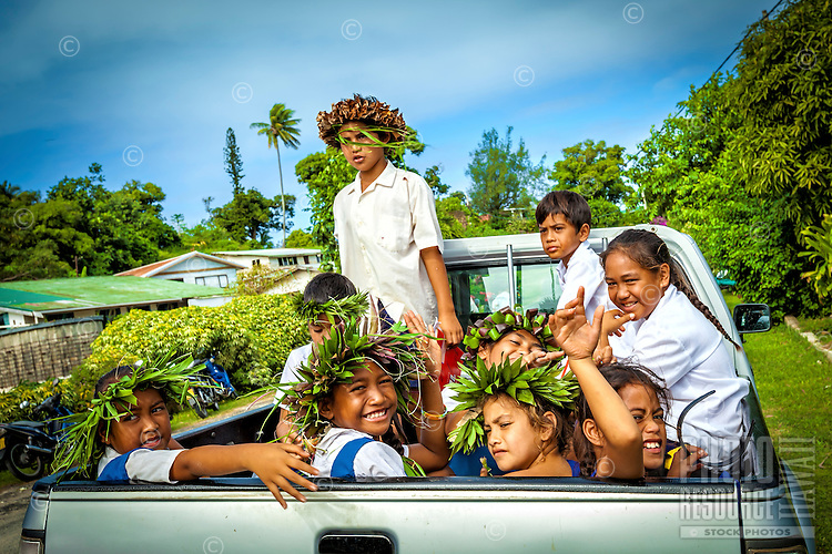 Kids with leafy headbands during the celebration of Makirau Haurua's investiture with the Teurukura Ariki title, Aitutaki Island, Cook Islands.