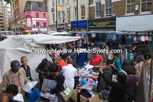 Petticoat Lane Sunday fashion and clothing market. Middlesex Street Shoreditch, east London UK