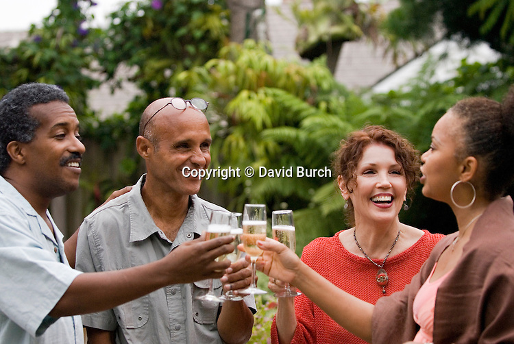 Ethnically mixed group of friends enjoying a champagne toast