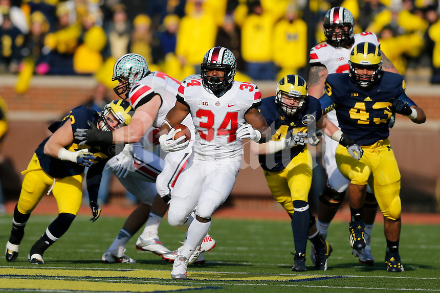 Ohio State Buckeyes running back Carlos Hyde (34) runs for a gain during the first half of the NCAA football game at Michigan Stadium in Ann Arbor, Michigan on Saturday, November 30, 2013. (Columbus Dispatch photo by Jonathan Quilter)