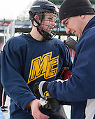 Ben Bahe (Merrimack - 17), Allan Del Valle, Jr. (Merrimack - Head Athletic Trainer) -  - The participating teams in Hockey East's first doubleheader during Frozen Fenway practiced on January 3, 2014 at Fenway Park in Boston, Massachusetts.