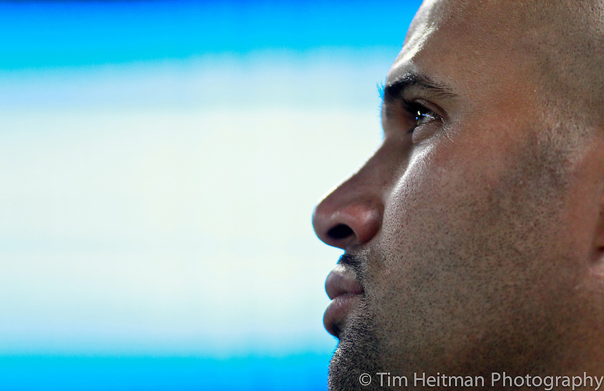 Jul 31, 2012; Arlington, TX, USA; Los Angeles Angels first baseman Albert Pujols (5) watches a replay during the eighth inning of the game against the Texas Rangers at Rangers Ballpark. The Angels beat the Rangers 6-2. Mandatory Credit: Tim Heitman-US PRESSWIRE