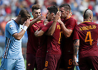 Calcio, Serie A: Roma vs Sampdoria. Roma, stadio Olimpico, 11 settembre 2016.<br /> Roma&rsquo;s Mohamed Salah, third from left, partially seen, celebrates with teammates after scoring during the Italian Serie A football match between Roma and Sampdoria at Rome's Olympic stadium, 11 September 2016. Roma won 3-2.<br /> UPDATE IMAGES PRESS/Isabella Bonotto