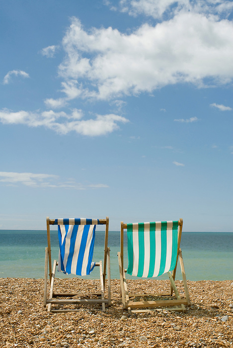 Two empty deck chairs on Brighton beach. England 2008.