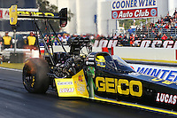 Feb 7, 2014; Pomona, CA, USA; NHRA top fuel dragster driver Richie Crampton during qualifying for the Winternationals at Auto Club Raceway at Pomona. Mandatory Credit: Mark J. Rebilas-