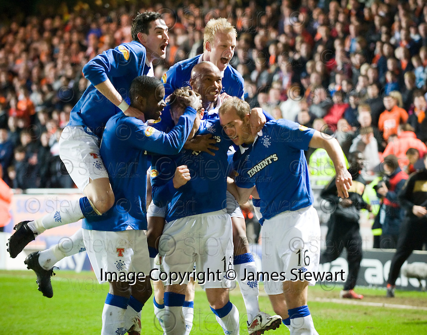 :: RANGERS' STEVEN WHITTAKER IS CONGRATULATED AFTER HE  SCORES THE SECOND FROM THE SPOT :: .19/04/2011   Copyright  Pic : James Stewart.sct_jsp012_dundee_utd_v_rangers .James Stewart Photography 19 Carronlea Drive, Falkirk. FK2 8DN      Vat Reg No. 607 6932 25.Telephone      : +44 (0)1324 570291 .Mobile              : +44 (0)7721 416997.E-mail  :  jim@jspa.co.uk.If you require further information then contact Jim Stewart on any of the numbers above.........