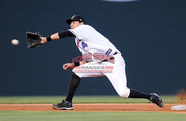 Wilmer Flores tries to make a play at second base at the 2010 South Atlantic League All-Star Game on Tuesday, June 22, 2010, at Fluor Field at the West End in Greenville, S.C. Photo by: Tom Priddy/Four Seam Images