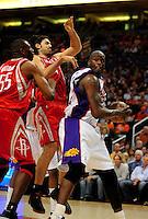 Mar. 22, 2008; Phoenix, AZ, USA; Phoenix Suns center (32) Shaquille O'Neal under pressure from Houston Rockets forward (4) Luis Scola at the US Airways Center. Mandatory Credit: Mark J. Rebilas