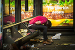 © Joel Goodman - 07973 332324 . Manchester , UK . 05/04/2015 . A man sits slumped over in a bus shelter at Piccadilly Bus Station in central Manchester . Revellers on a Saturday night out during the Easter Bank Holiday weekend . Photo credit : Joel Goodman
