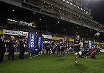 Richie McCaw leads his team on to the park before the first international rugby test at Eden Park, Auckland, New Zealand, Saturday, June 02, 2007. The All Blacks beat France 42-11.