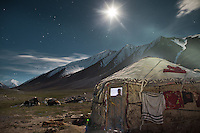 The yurt of a newly married couple lit by full moon, on the night before a trip down to the lower valley..A few years ago, envoys from the government in faraway Kyrgyzstan have offered help to the Afghan Kyrgyz community, proposing them to relocate in a valley in Kyrgyzstan? For most, it remains a difficult decision, logistically and psychologically, to abandon their homeland...Young couple - Nemat Ullah and Woolook Bu's yurt..Daily life at the Khan (chief) summer camp of Kara Jylga...Trekking through the high altitude plateau of the Little Pamir mountains (average 4200 meters) , where the Afghan Kyrgyz community live all year, on the borders of China, Tajikistan and Pakistan.
