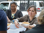 "Juani Martinez, a Methodist woman in Nuevo Laredo, Mexico, serves food to Cuban immigrants in that city's Plaza Benito Juarez on March 3, 2017. Hundreds of Cubans are stuck in the border city, caught in limbo by the elimination in January of the infamous ""wet foot, dry foot"" policy of the United States. They are not allowed to enter the U.S. yet don't want to return to Cuba. Many of the city's churches have become temporary shelters for the immigrants, and congregations rotate responsibility for feeding the Cubans, who have slowly been forced to appreciate Mexican cuisine. Such solidarity from ordinary Mexicans is being tested these days, as not only are the Cubans stuck at the border, but the U.S. has stepped up deportations of Mexican nationals, while at the same time detaining many undocumented workers from other nations and simply dumping them on the US-Mexico border. Martinez is a member of the Aposento Alto Methodist Church in Nuevo Laredo."