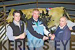 RESERVE WIN: Nicholas Flynn, Farranfore, whose heifer won the reserve champion at the Castleisland Mart show and sale last Friday, the heifer was sold for €1,500 l-r: Paul Conroy (judge), Nicholas Flynn (winner) and Jimmy Roche (Castleisland mart).