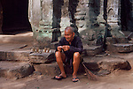 OLD MAN SELLS TRINKETS IN ANGKOR WAT