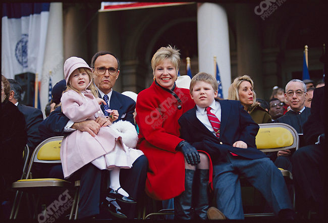 New York City Mayor Rudolph Giuliani, with his wife, Donna Hanover, and their children, Andrew and Caroline, at Giuliani's mayoral inauguration ceremony. New York City, New York, USA, January 1994.