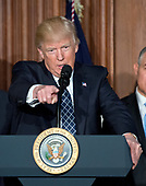 United States President Donald J. Trump makes remarks prior to signing an Energy Independence Executive Order at the Environmental Protection Agency (EPA) Headquarters in Washington, DC on Thursday, March 28, 2017.  The order reverses the Obama-era climate change policies.<br /> Credit: Ron Sachs / Pool via CNP