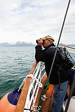 ALASKA, Homer, a man takes a ride on the Danny J boat from the Homer Spit to Halibut Cove