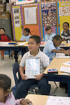 Oakland CA 2nd grade student showing off math calculation in class