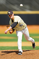 Wake Forest Demon Deacons starting pitcher Brian Holmes #45 follows through on his delivery against the Florida State Seminoles at Wake Forest Baseball Park on March 25, 2012 in Winston-Salem, North Carolina.  The Demon Deacons defeated the Seminoles 7-5.  (Brian Westerholt/Four Seam Images)