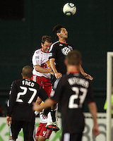 Branko Boskovic (8) of D.C. United beats Teemu Tainio (2) of the New York Red Bulls to a high ball during an MLS match at RFK Stadium, in Washington D.C. on April 21 2011. Red Bulls won 4-0.
