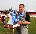 Stevenage manager Graham Westley celebrates with the Blue Square Premier championship trophy after the Blue Square Premier match between Stevenage Borough and York City at the Lamex Stadium, Broadhall Way, Stevenage on Saturday 24th April, 2010..© Kevin Coleman 2010 ..