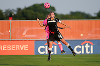 Becky Edwards (14) of the Western New York Flash goes up for a header. The Western New York Flash defeated Sky Blue FC 2-0 during a Women's Professional Soccer (WPS) match at Yurcak Field in Piscataway, NJ, on July 17, 2011.