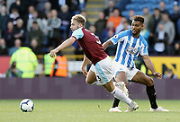 Burnley's Charlie Taylor is fouled by Huddersfield Town's Steve Mounie<br /> <br /> Photographer Rich Linley/CameraSport<br /> <br /> The Premier League - Burnley v Huddersfield Town - Saturday 6th October 2018 - Turf Moor - Burnley<br /> <br /> World Copyright &copy; 2018 CameraSport. All rights reserved. 43 Linden Ave. Countesthorpe. Leicester. England. LE8 5PG - Tel: +44 (0) 116 277 4147 - admin@camerasport.com - www.camerasport.com