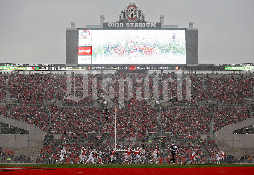Ohio State Buckeyes quarterback Braxton Miller (5) runs with the ball in the 1st quarter in the snow against Indiana Hoosiers during their College football game at Ohio Stadium in Columbus, Ohio on November 23, 2013.  (Dispatch photo by Kyle Robertson)