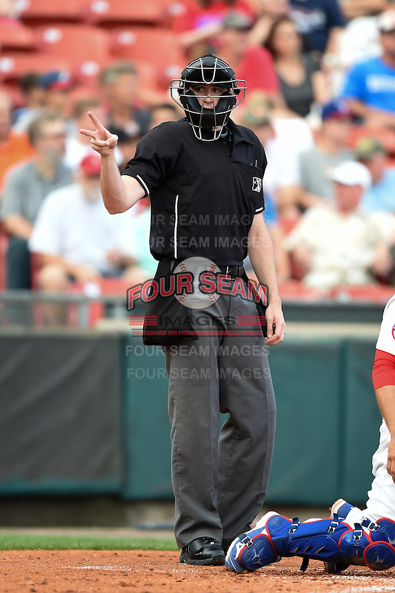Umpire Nick Lentz signals for two baseballs during a game between the Pawtucket Red Sox  and Buffalo Bisons on August 26, 2014 at Coca-Cola Field in Buffalo, New  York.  Buffalo defeated Pawtucket 15-2.  (Mike Janes/Four Seam Images)