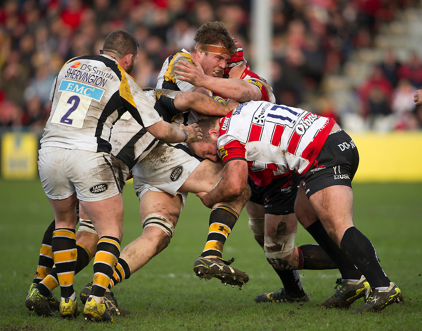 Wasps' James Cannon is tackled by Gloucester Rugby's Yann Thomas<br /> <br /> Photographer Ashley Western/CameraSport<br /> <br /> Rugby Union - Aviva Premiership Round 15 - Gloucester Rugby v Wasps - Saturday 5th March 2016 - Kingsholm Stadium - Gloucester<br /> <br /> &copy; CameraSport - 43 Linden Ave. Countesthorpe. Leicester. England. LE8 5PG - Tel: +44 (0) 116 277 4147 - admin@camerasport.com - www.camerasport.com