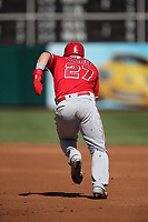 OAKLAND, CA - MARCH 31:  Mike Trout #27 of the Los Angeles Angels runs the bases against the Oakland Athletics during the game at the Oakland Coliseum on Sunday, March 31, 2019 in Oakland, California. (Photo by Brad Mangin)