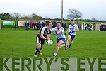 Martin Ferris (Ardfert) in action with denis Daly (St Mary's) in the County Intermediate Football Championship round 1 at Ardfert on Saturdayn evening