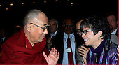 Valarie Jarrett talks to the Dalai Lama as United States President Barack Obama attends the National Prayer Breakfast at the Washington Hilton Hotel in Washington, D.C. on February 5, 2015.  U.S. and international leaders from different parties and religions gather annually at this event for an hour devoted to faith and prayer.<br /> Credit: Dennis Brack / Pool via CNP