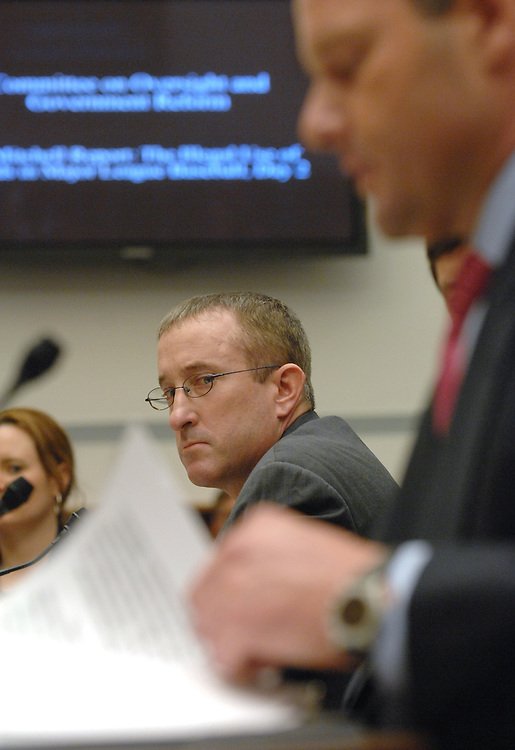 Brian McNamee, left, former personal trainer to Roger Clemens, listens to Clemens, former MLB pitcher, make an opening statement at a House Oversight and Government Reform Hearing on steroid use in baseball.