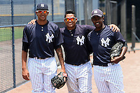 GCL Yankees 1 Reynaldo Polanco (35), Alvaro Noriega (13) and Christopher Cabrera (6) before the second game of a doubleheader against the GCL Braves on July 1, 2014 at the Yankees Minor League Complex in Tampa, Florida.  GCL Braves defeated the GCL Yankees 1 by a score of 3-1.  (Mike Janes/Four Seam Images)