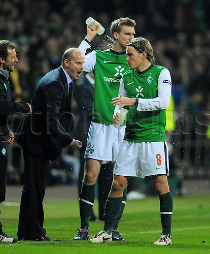 18 03 2010 UEFA Europe League Season 2009 Eighth finals SV Werder Bremen versus FC Valencia  team manager Thomas Schaaf left with his Players Per Mertesacker centre and Clemens Fritz right .